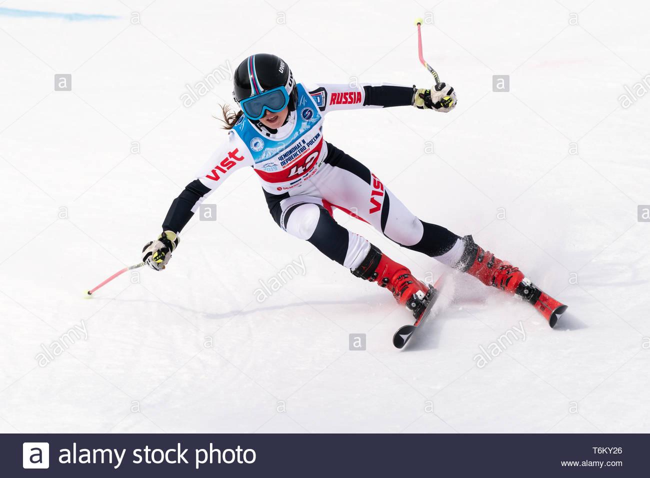 KAMCHATKA PENINSULA, RUSSIA - APR 2, 2019: Mountain skier Dyachenko Ellina (Sakhalin) skiing down mount slope. Russian Women's Alpine Skiing Cup, Inte - Stock Image