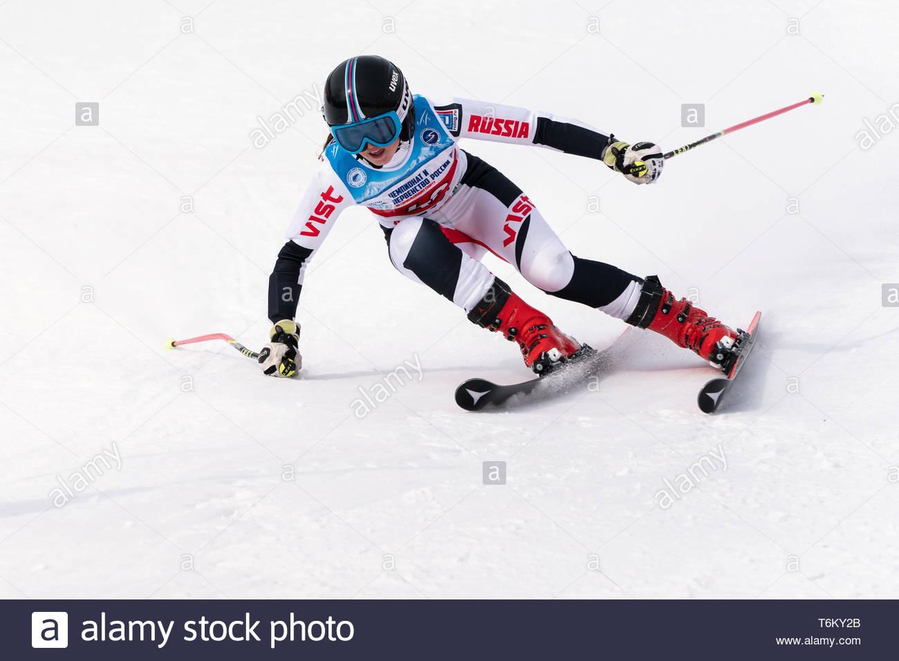 KAMCHATKA PENINSULA, RUSSIA - APR 2, 2019: Mountain skier Ellina Dyachenko (Sakhalin) skiing down mount. International Ski Federation Championship, Ru - Stock Image