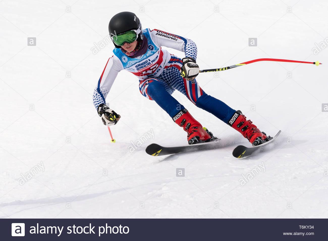KAMCHATKA, RUSSIA - APR 2, 2019: Mountain skier Anna Martynova (Leningrad Region) skiing down mount slope. Russian Women's Alpine Skiing Cup, Internat - Stock Image