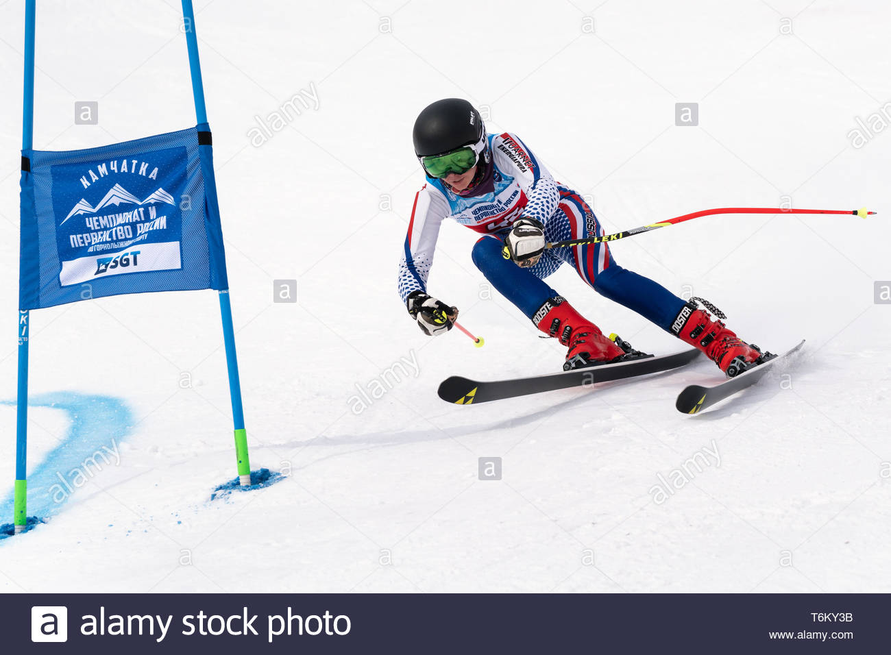 KAMCHATKA PENINSULA, RUSSIA - APR 2, 2019: Mountain skier Anna Martynova (Leningrad Region) skiing down mount. International Ski Federation Championsh - Stock Image