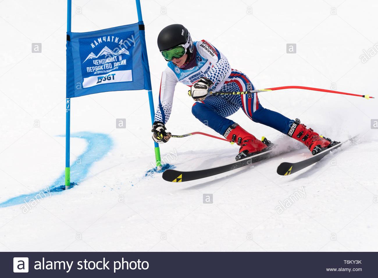 KAMCHATKA, RUSSIA - APRIL 2, 2019: Russian Women's Alpine Skiing Cup, International Ski Federation Championship - giant slalom. Mountain skier Martyno - Stock Image