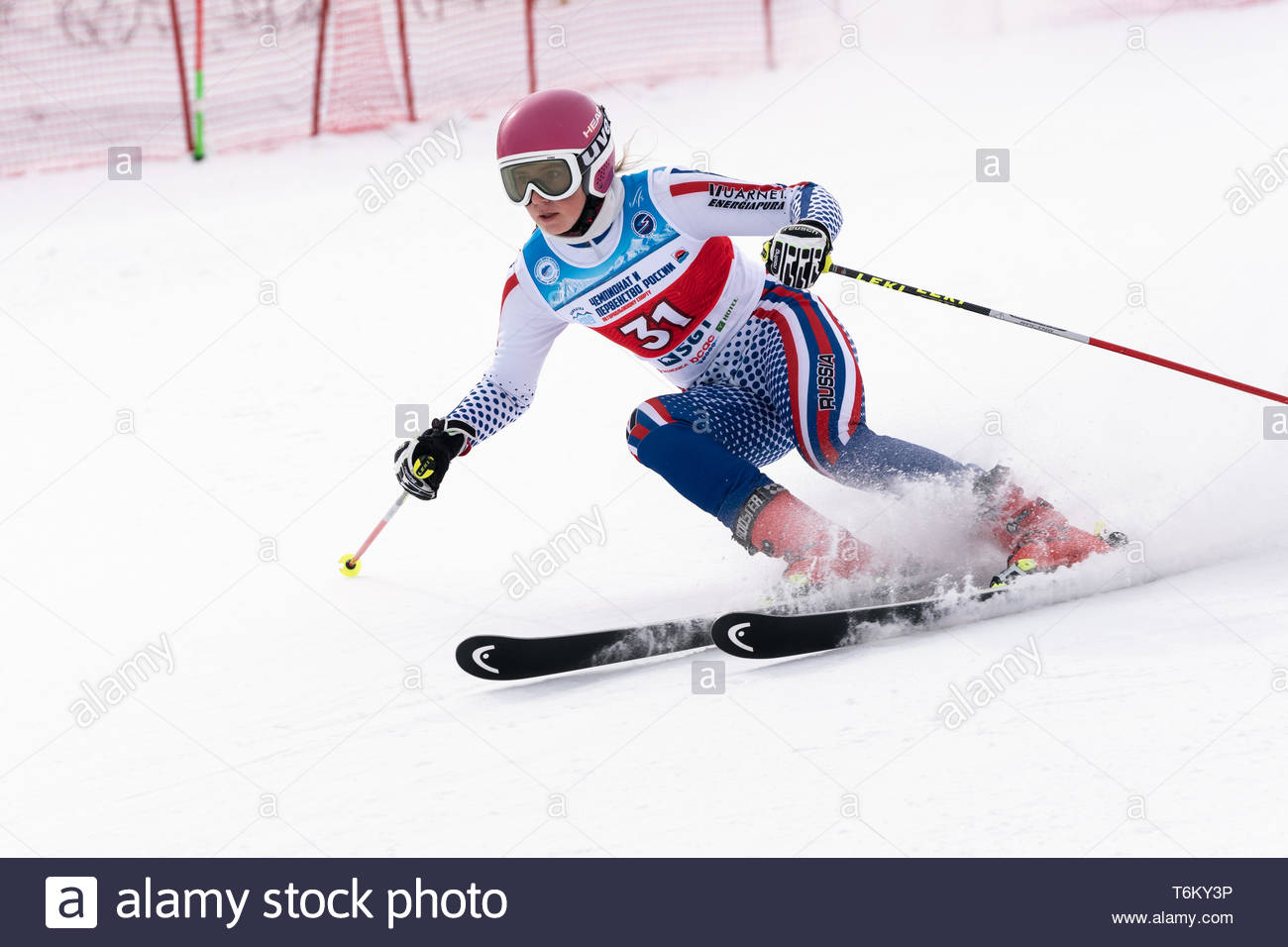KAMCHATKA PENINSULA, RUSSIA - APR 2, 2019: Mountain skier Kryukova Dariya (Chelyabinsk) skiing down mount. Russian Women's Alpine Skiing Cup, Internat - Stock Image