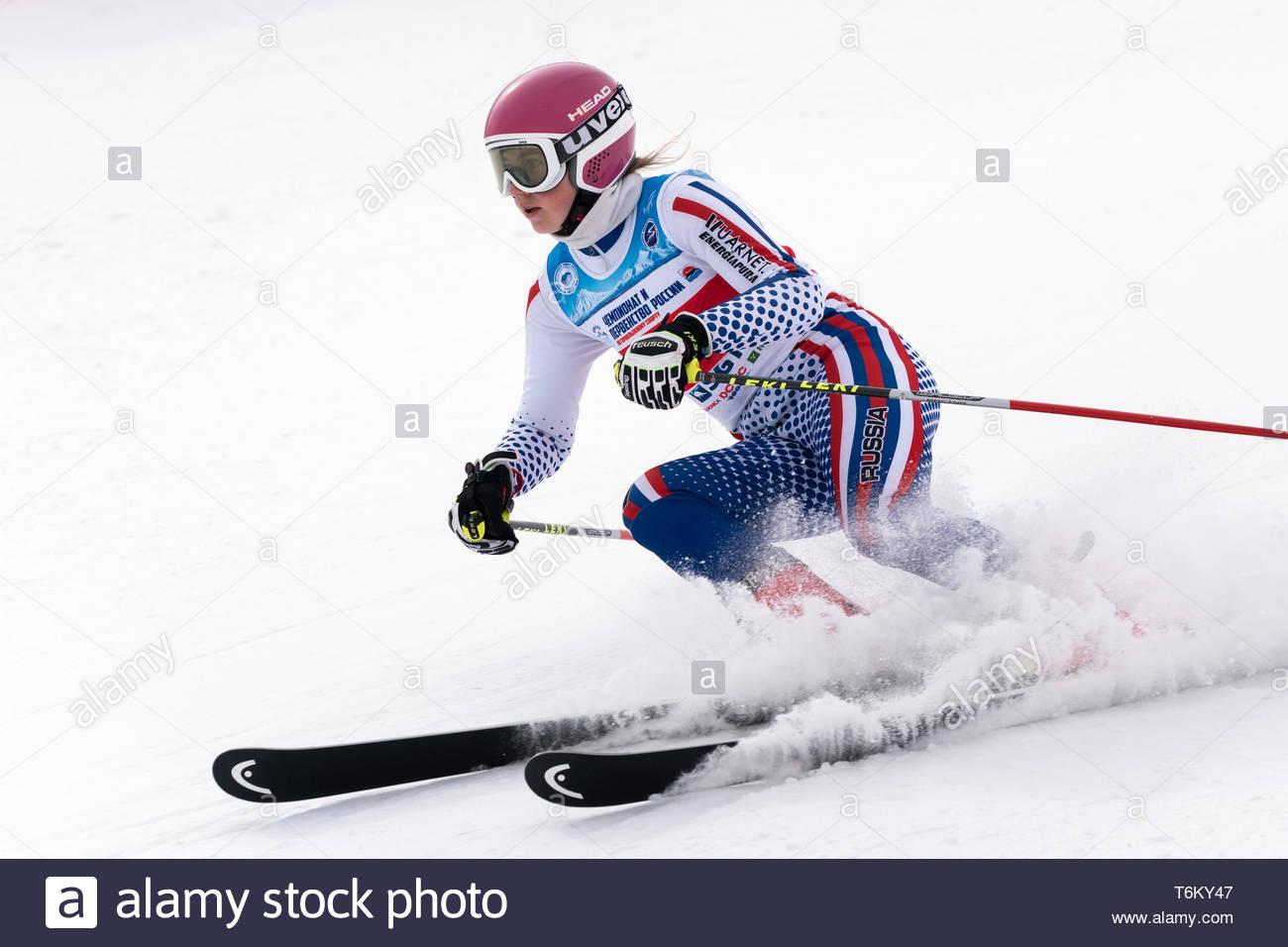 KAMCHATKA PENINSULA, RUSSIA - APRIL 2, 2019: Mountain skier Dariya Kryukova (Chelyabinsk) skiing down mount. International Ski Federation Championship - Stock Image