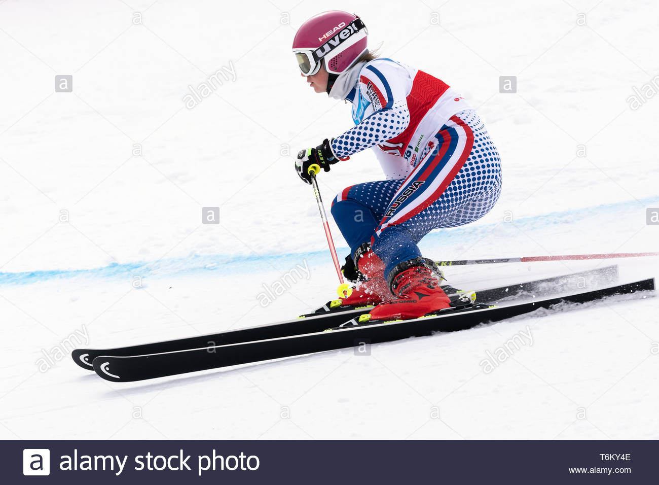 KAMCHATKA PENINSULA, RUSSIA - APRIL 2, 2019: International Ski Federation Championship, Russian Women's Alpine Skiing Cup, giant slalom. Mountain skie - Stock Image