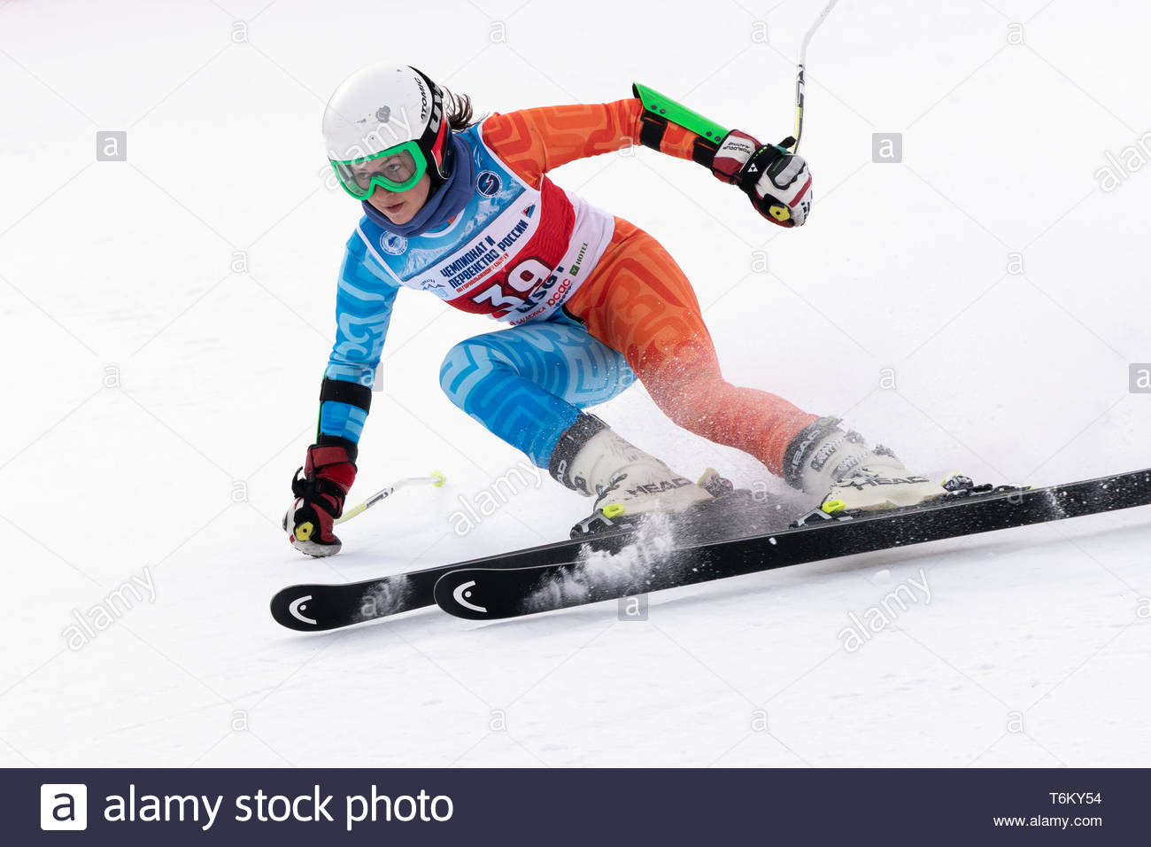 KAMCHATKA PENINSULA, RUSSIA - APR 2, 2019: Mountain skier Victoria Fugleva (Sakhalin Region) skiing down mount. Russian Women's Alpine Skiing Cup Inte - Stock Image