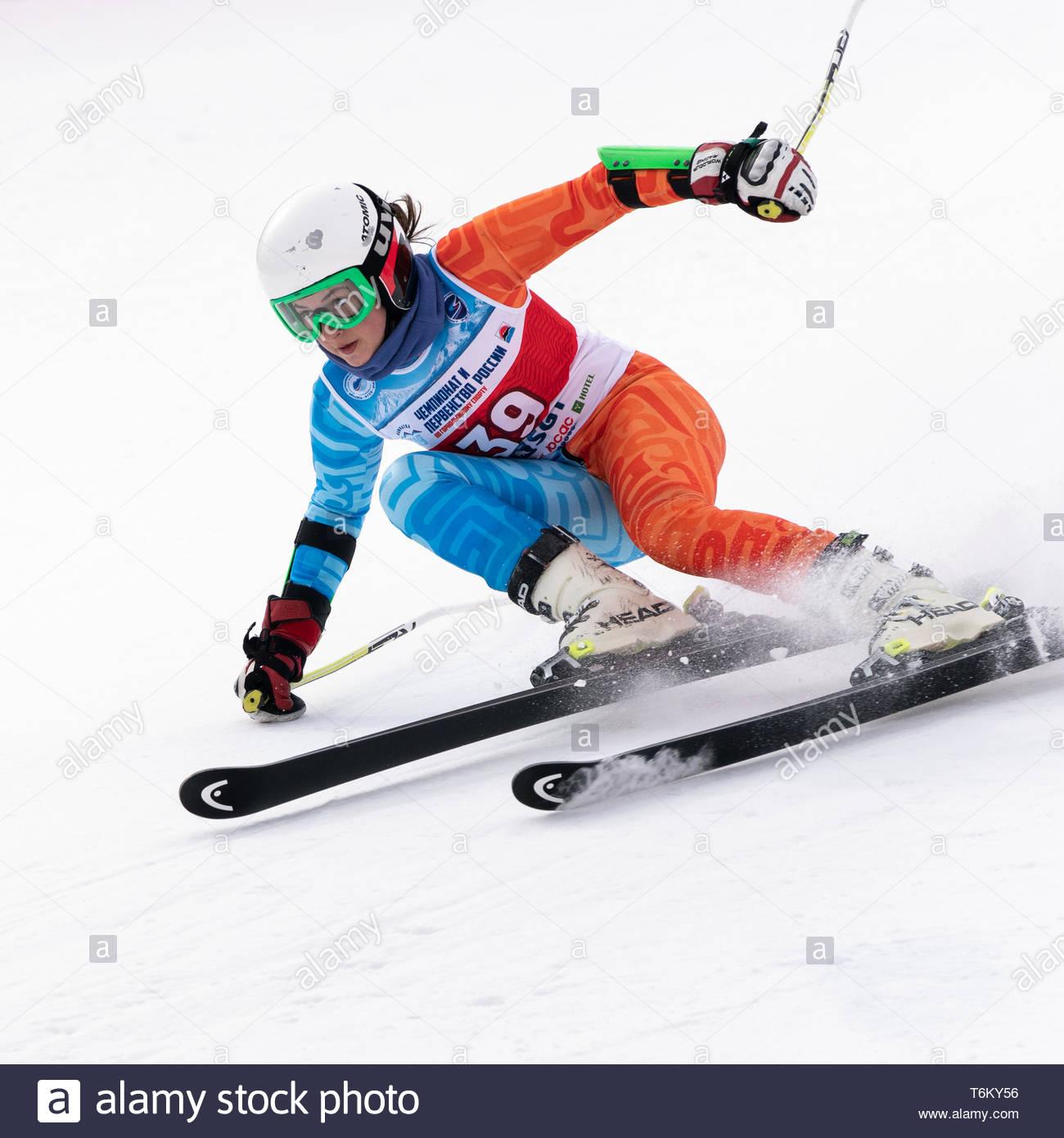 KAMCHATKA PENINSULA, RUSSIA - APR 2, 2019: Mountain skier Fugleva Victoria (Sakhalin Region) skiing down mount. International Ski Federation Champions - Stock Image