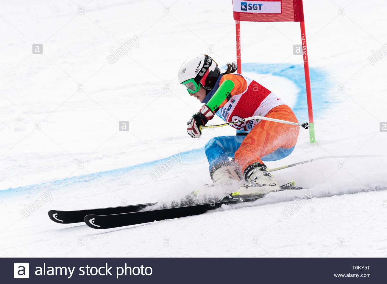 KAMCHATKA PENINSULA, RUSSIA - APR 2, 2019: Mountain skier Fugleva Victoria (Sakhalin Region) skiing down mount. Russian Women's Alpine Skiing Cup Inte - Stock Image