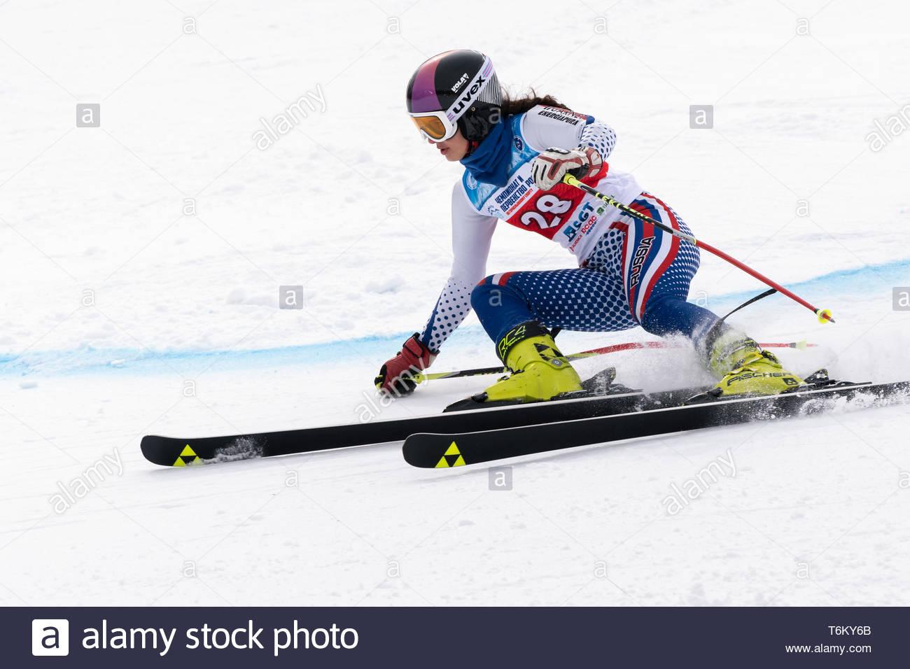KAMCHATKA PENINSULA, RUSSIA - APR 2, 2019: Mountain skier Anna Vakhnina (Krasnoyarsk Region) skiing down mount. Russian Women's Alpine Skiing Cup Inte - Stock Image