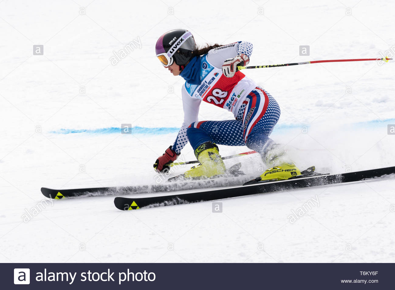 KAMCHATKA PENINSULA, RUSSIA - APR 2, 2019: Mountain skier Vakhnina Anna (Krasnoyarsk Region) skiing down mount. International Ski Federation Champions - Stock Image