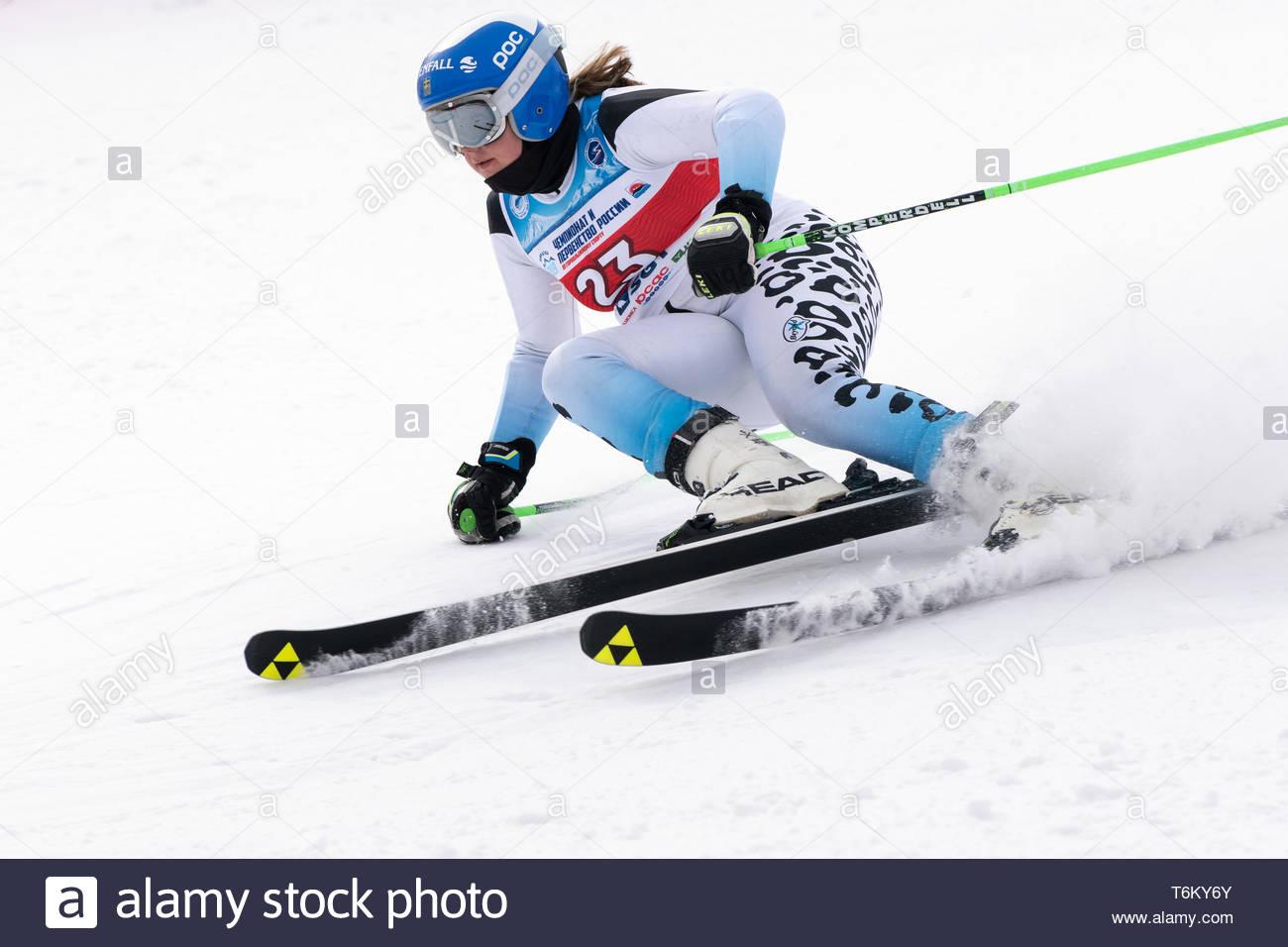 KAMCHATKA PENINSULA, RUSSIA - APR 2, 2019: Mountain skier Minaeva Anastasia (Murmansk) skiing down mount slope. Russian Women's Alpine Skiing Cup Inte - Stock Image