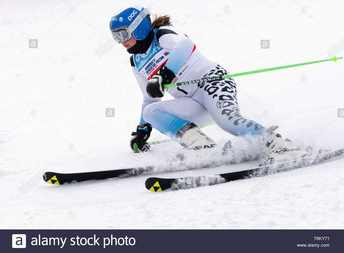 KAMCHATKA PENINSULA, RUSSIA - APR 2, 2019: Mountain skier Minaeva Anastasia (Murmansk) skiing down mount slope. International Ski Federation Champions - Stock Image