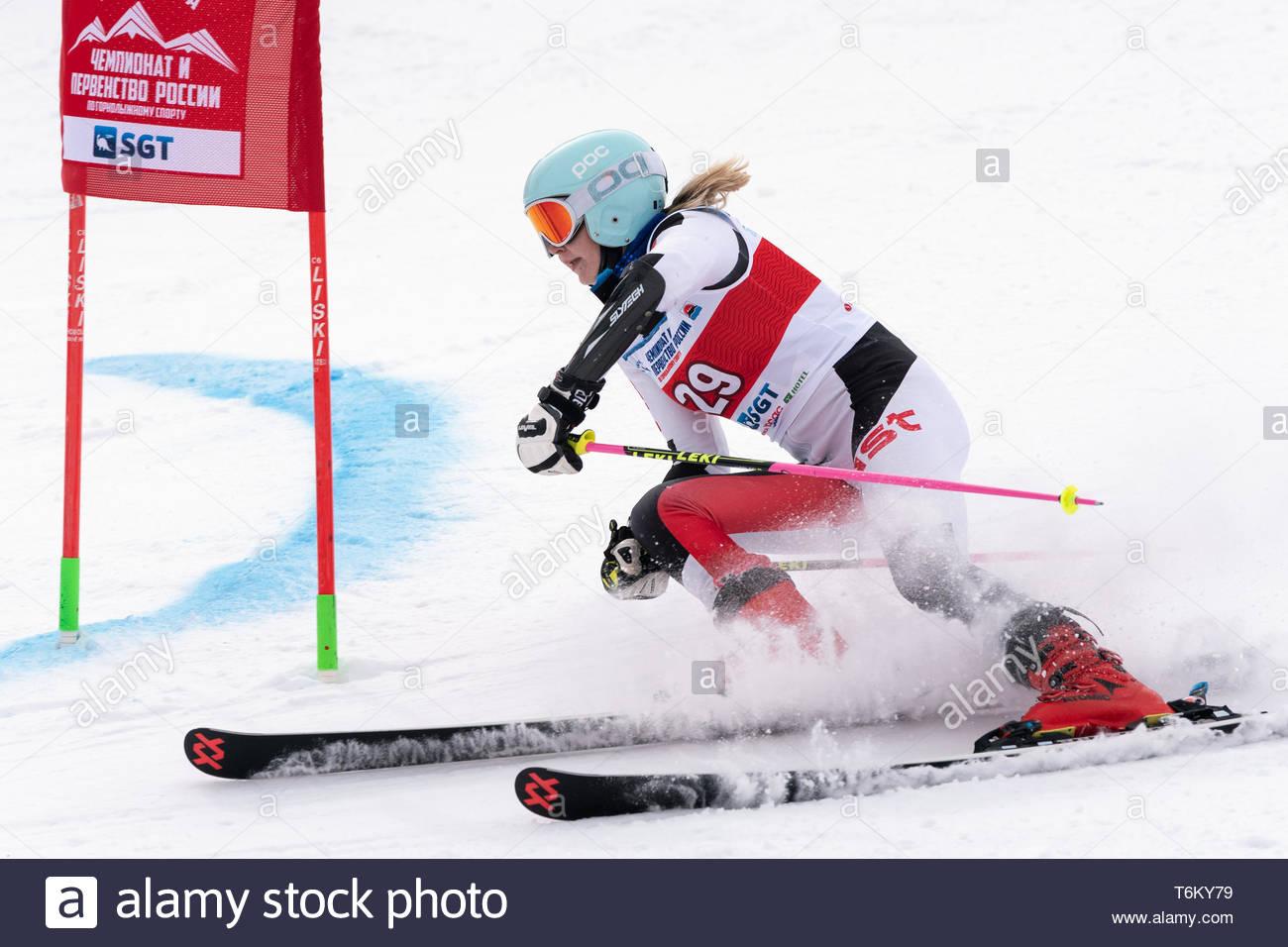 KAMCHATKA PENINSULA, RUSSIA - APRIL 2, 2019: Mountain skier Elizaveta Elesina (Sverdlovsk) skiing down mount. Russian Women's Alpine Skiing Cup, Inter - Stock Image