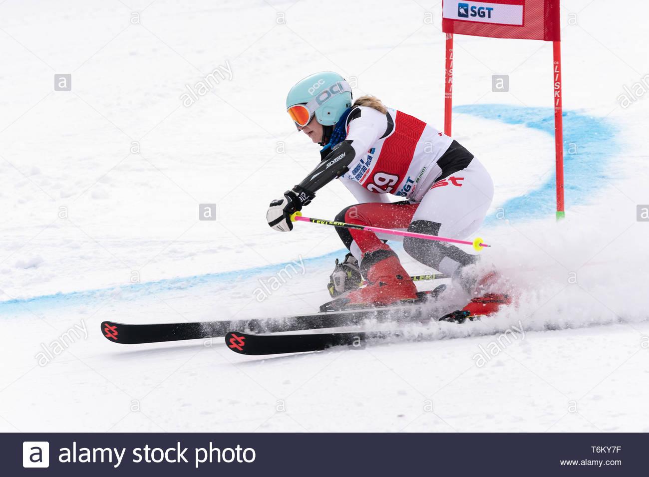 KAMCHATKA PENINSULA, RUSSIA - APRIL 2, 2019: Mountain skier Elizaveta Elesina (Sverdlovsk) skiing down mount. International Ski Federation, Championsh - Stock Image