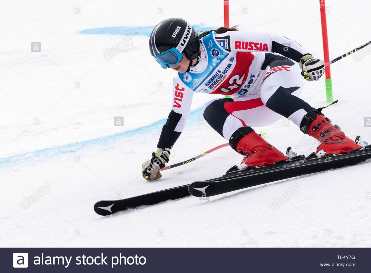 KAMCHATKA PENINSULA, RUSSIA - APRIL 2, 2019: Mountain skier Dyachenko Ellina (Sakhalin) skiing down mount. Russian Women's Alpine Skiing Cup, Internat - Stock Image