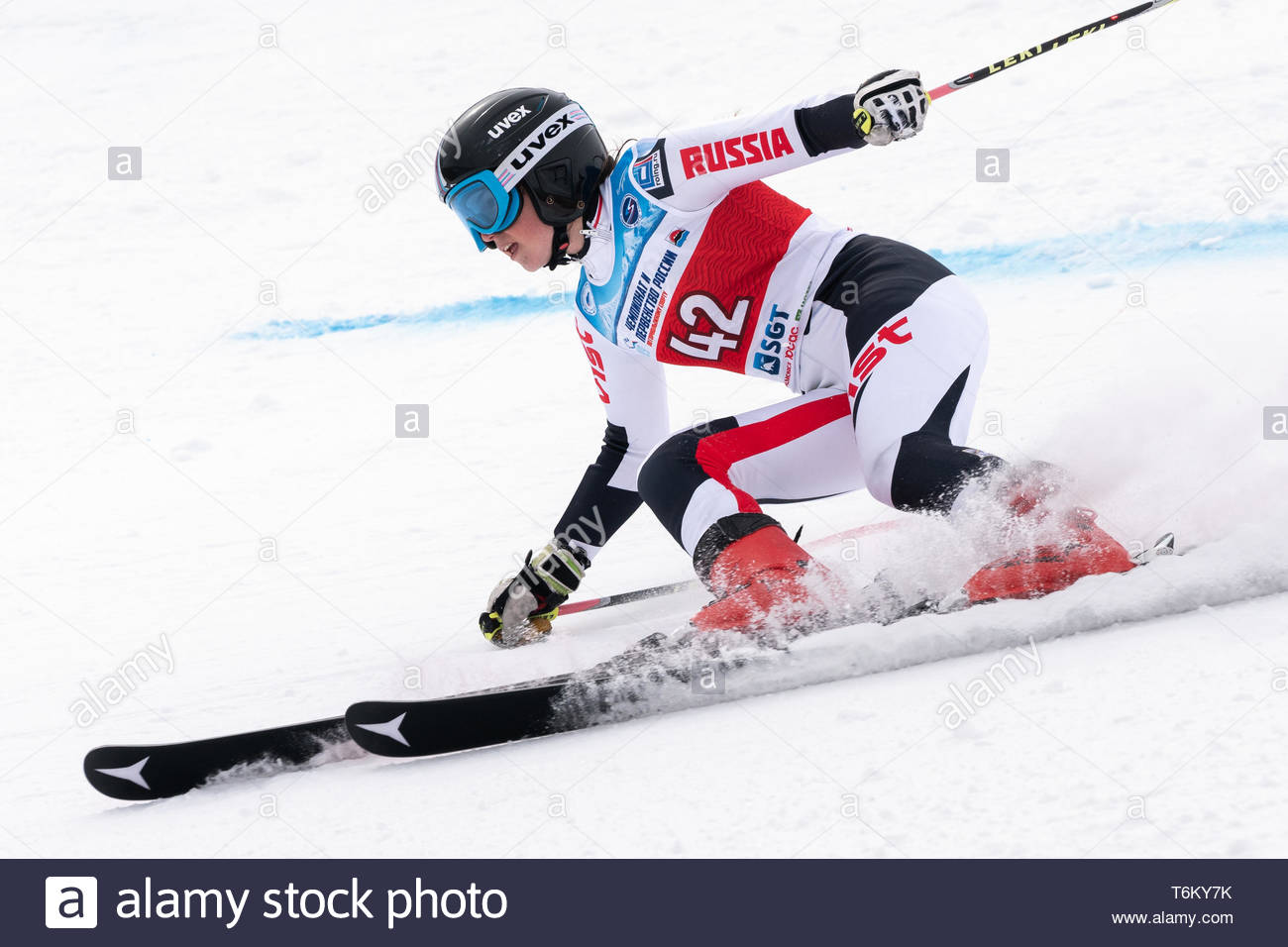 KAMCHATKA PENINSULA, RUSSIA - APRIL 2, 2019: Mountain skier Ellina Dyachenko (Sakhalin) skiing down mount. International Ski Federation, Championship  - Stock Image
