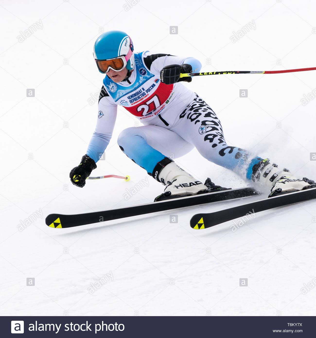 KAMCHATKA PENINSULA, RUSSIA - APRIL 2, 2019: Mountain skier Gavrish Veronika (Murmansk) skiing down mount. Russian Women's Alpine Skiing Cup, Internat - Stock Image