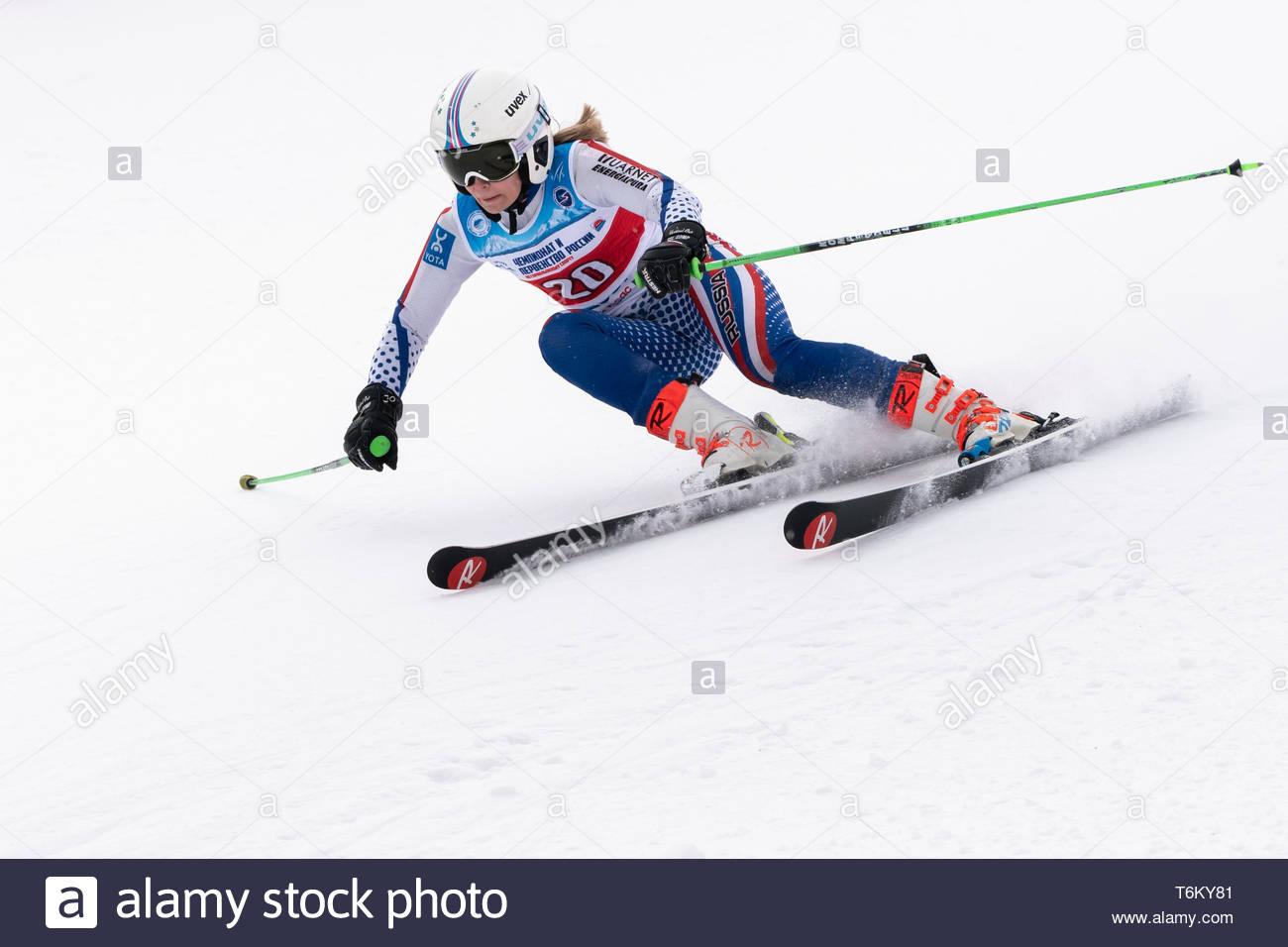 KAMCHATKA PENINSULA, RUSSIA - APR 2, 2019: Mountain skier Shubina Anastasia (Krasnoyarsk) skiing down mount. Russian Women's Alpine Skiing Cup, Intern - Stock Image