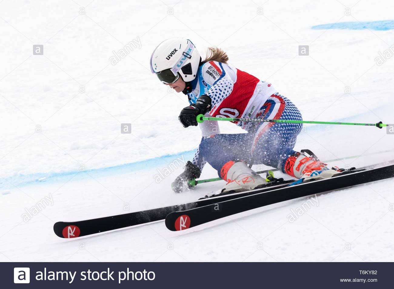 KAMCHATKA PENINSULA, RUSSIA - APR 2, 2019: Mountain skier Anastasia Shubina (Krasnoyarsk) skiing down mount. International Ski Federation, Championshi - Stock Image