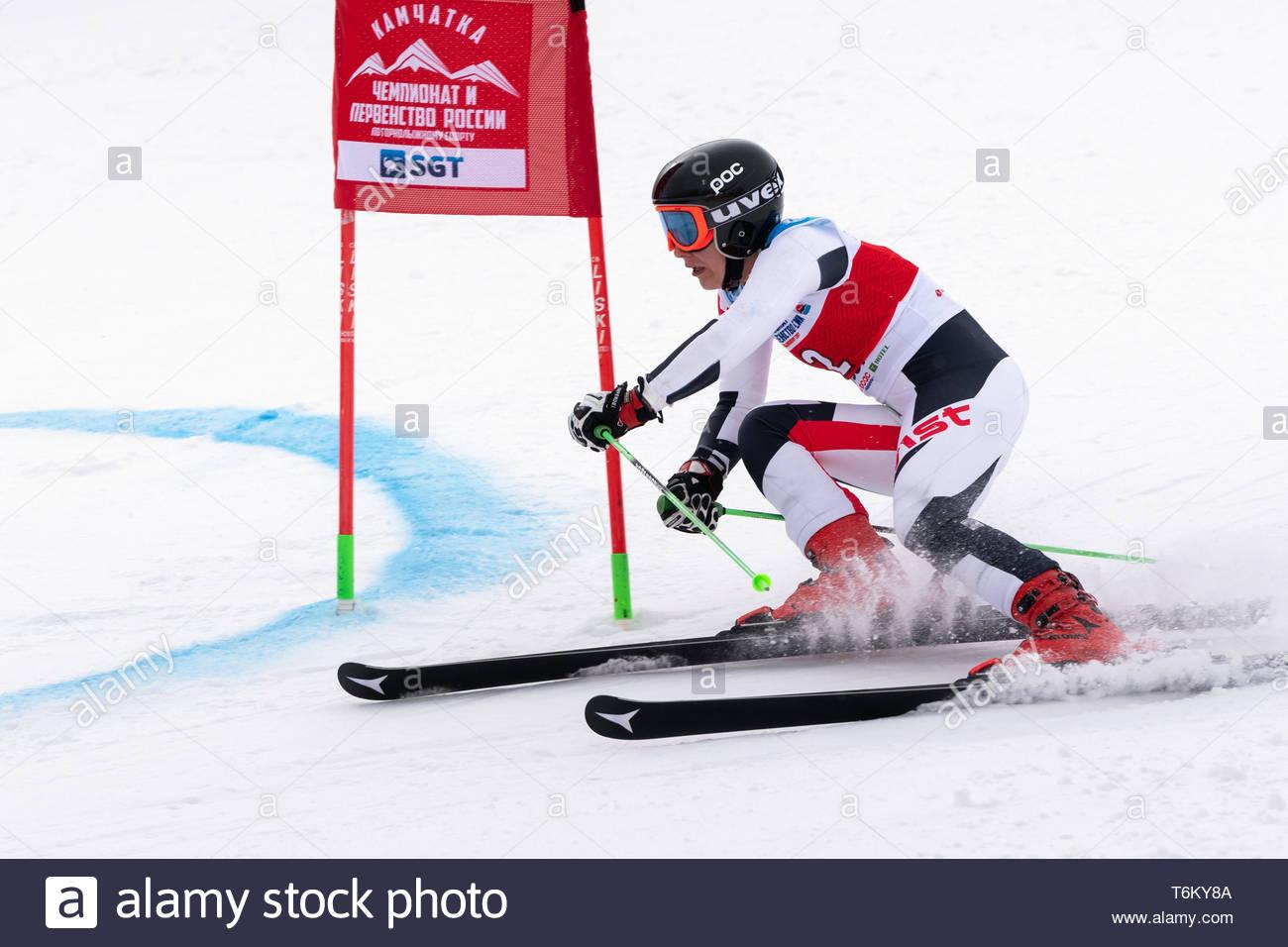 KAMCHATKA, RUSSIA - APR 2, 2019: Russian Women's Alpine Skiing Cup, International Ski Federation Championship, giant slalom. Mountain skier Timchenko  - Stock Image