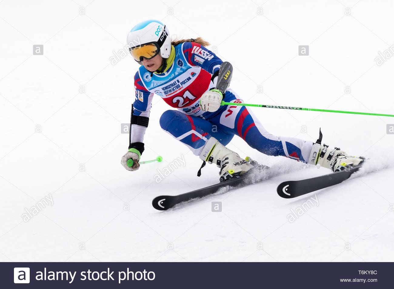 KAMCHATKA PENINSULA, RUSSIA - APRIL 2, 2019: Mountain skier Fedorova Ksenia (Moscow) skiing down mount. Russian Women's Alpine Skiing Cup, Internation - Stock Image