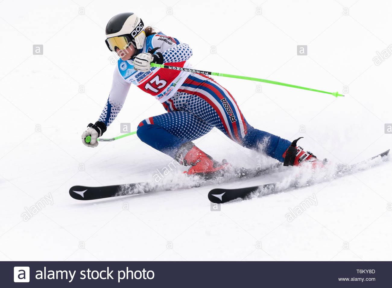 KAMCHATKA, RUSSIA - APRIL 2, 2019: Mountain skier Khartsyzova Alena (St. Petersburg) skiing down mount slope. Russian Women's Alpine Skiing Cup, Inter - Stock Image