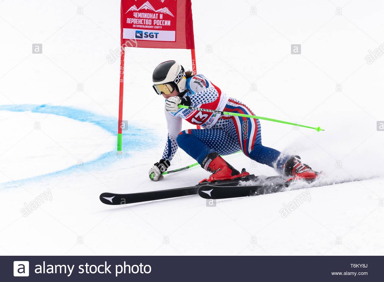 KAMCHATKA, RUSSIA - APR 2, 2019: Mountain skier Alena Khartsyzova (St. Petersburg) skiing down mount slope. International Ski Federation Championship, - Stock Image