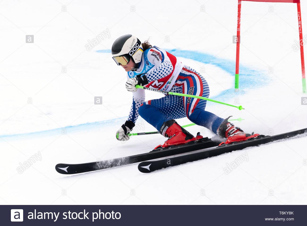 KAMCHATKA, RUSSIA - APR 2, 2019: Russian Women's Alpine Skiing Cup, International Ski Federation Championship, giant slalom. Mountain skier Khartsyzov - Stock Image