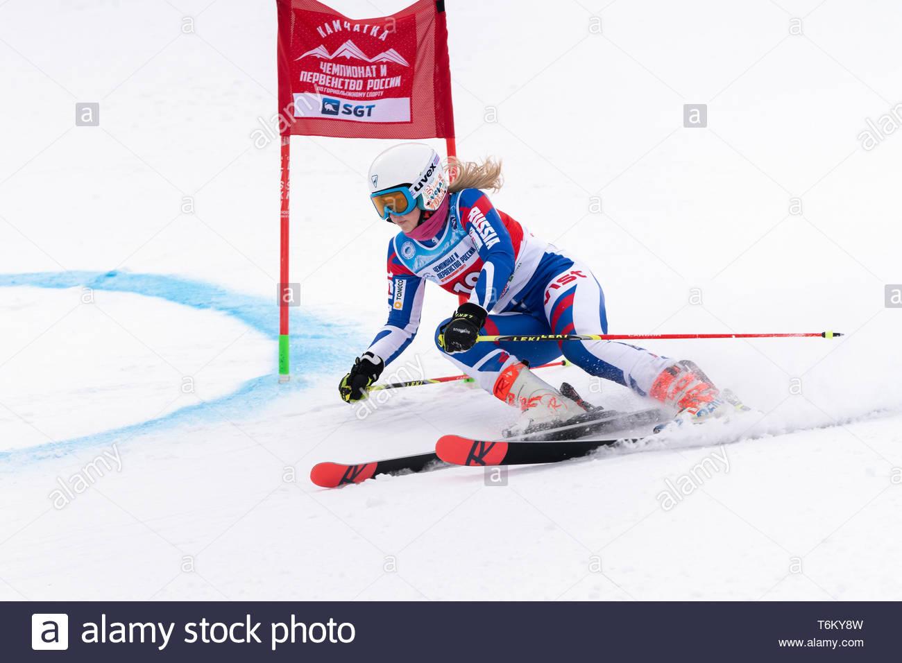 KAMCHATKA, RUSSIA - APR 2, 2019: Mountain skier Popova Yaroslava (Krasnoyarsk Region) skiing down mount slope. Russian Women's Alpine Skiing Cup, Inte - Stock Image