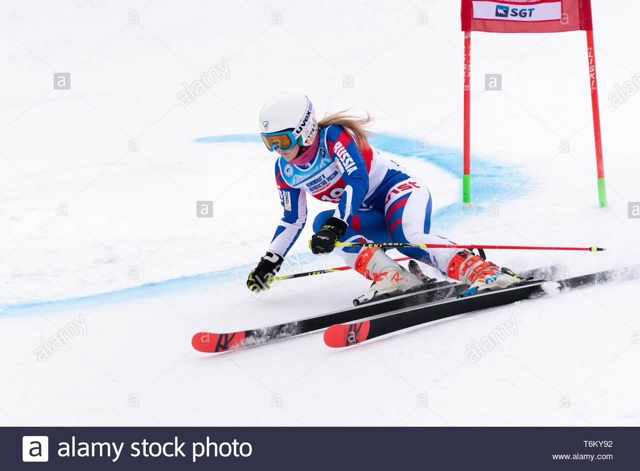 KAMCHATKA, RUSSIA - APR 2, 2019: Mountain skier Yaroslava Popova (Krasnoyarsk Region) skiing down mount slope. International Ski Federation Championsh - Stock Image