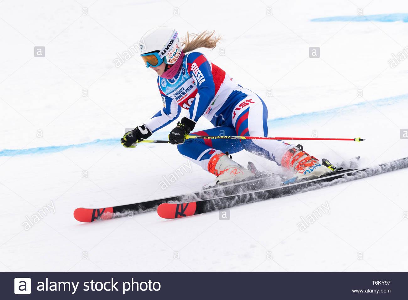 KAMCHATKA, RUSSIA - APR 2, 2019: Russian Women's Alpine Skiing Cup, International Ski Federation Championship giant slalom. Mountain skier Popova Yaro - Stock Image