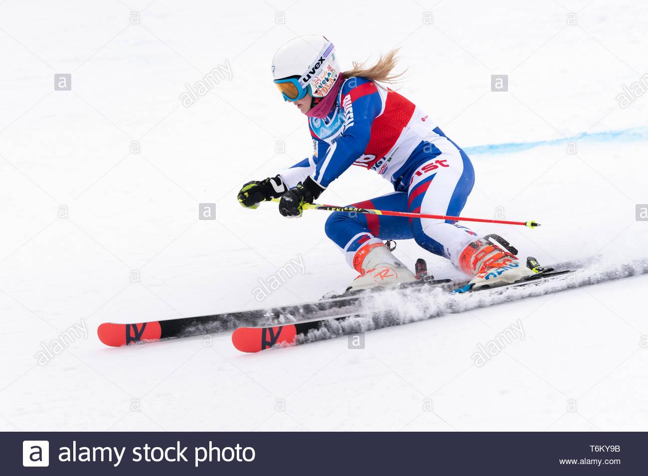 KAMCHATKA, RUSSIA - APR 2, 2019: International Ski Federation Championship, Russian Women's Alpine Skiing Cup giant slalom. Mountain skier Yaroslava P - Stock Image