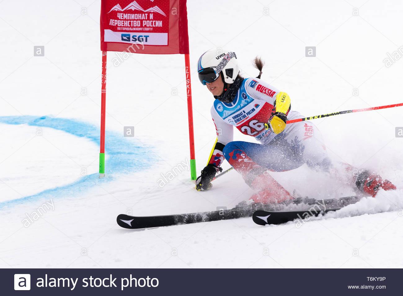 KAMCHATKA, RUSSIA - APR 2, 2019: Mountain skier Arkhipova Sofya (Sverdlovsk Region) skiing down mount slope. Russian Women's Alpine Skiing Cup, Intern - Stock Image