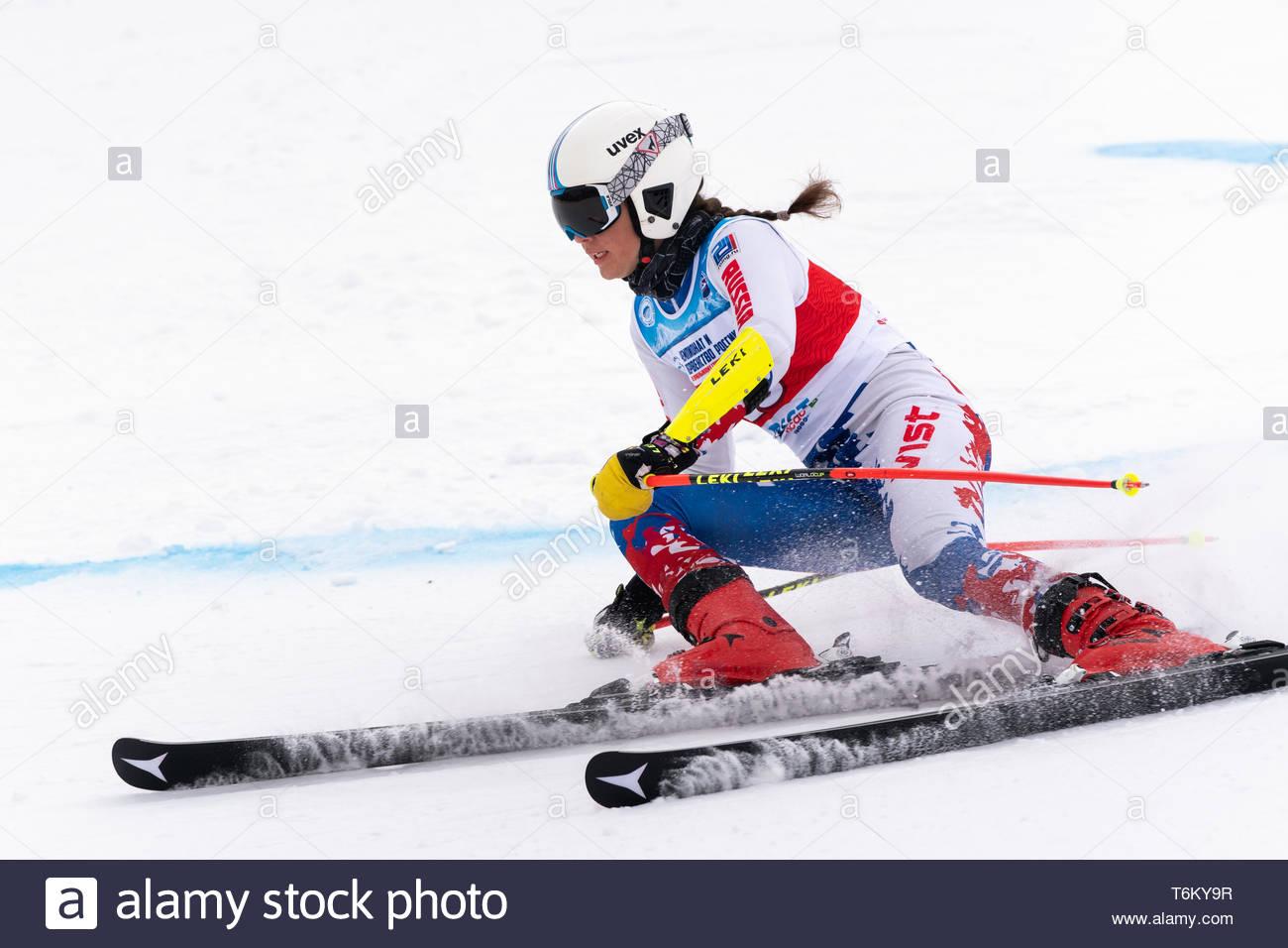 KAMCHATKA, RUSSIA - APRIL 2, 2019: Mountain skier Sofya Arkhipova (Sverdlovsk Region) skiing down mount slope. International Ski Federation Championsh - Stock Image