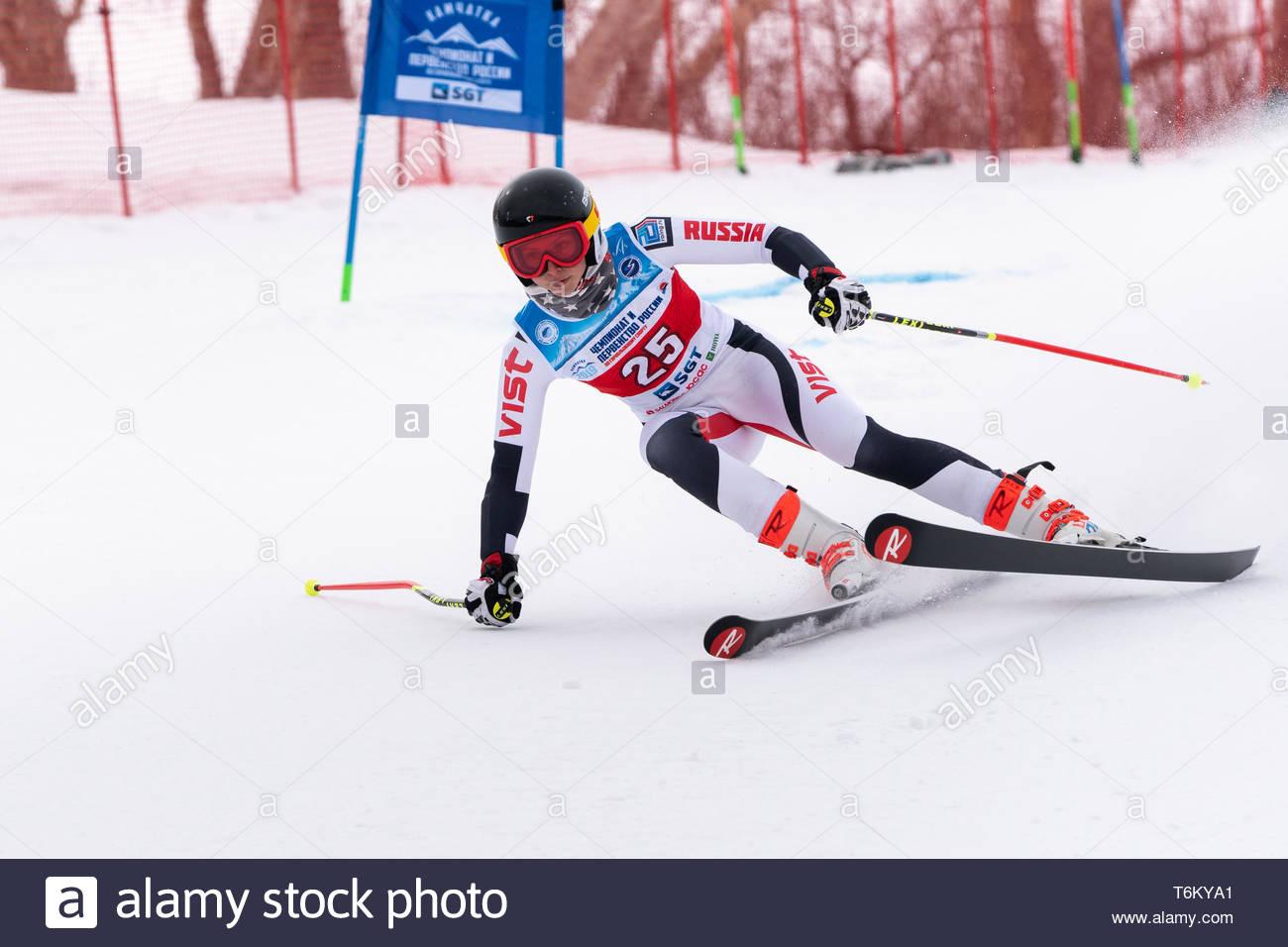 KAMCHATKA PENINSULA, RUSSIA - APRIL 2, 2019: Mountain skier Sautieva Darya (Moscow) skiing down mount slope. Russian Women's Alpine Skiing Cup, Intern - Stock Image