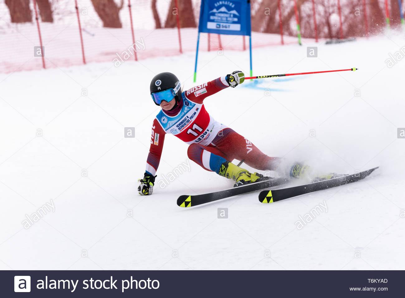 KAMCHATKA PENINSULA, RUSSIA - APRIL 2, 2019: Mountain skier Sofya Krokhina (Moscow) skiing down mount slope. Russian Women's Alpine Skiing Cup, Intern - Stock Image