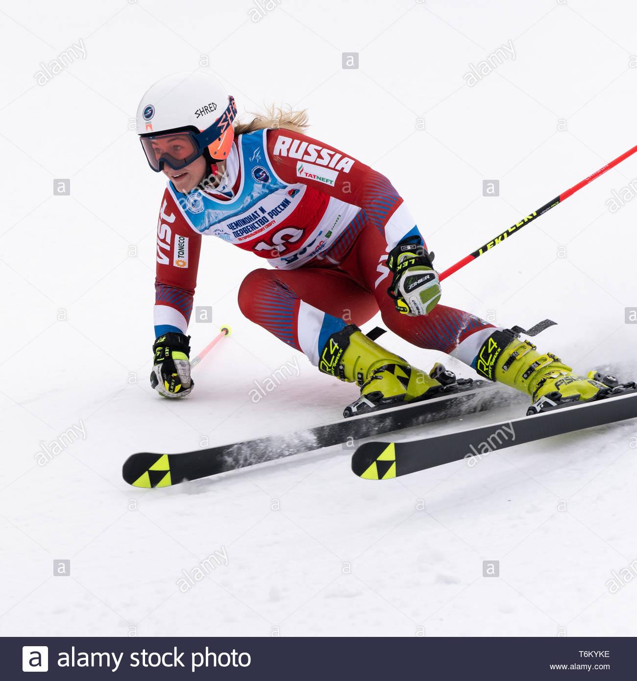 KAMCHATKA PENINSULA, RUSSIA - APR 2, 2019: Mountain skier Rinata Abdulkayumova (Kamchatka) skiing down mount. International Ski Federation Championshi - Stock Image