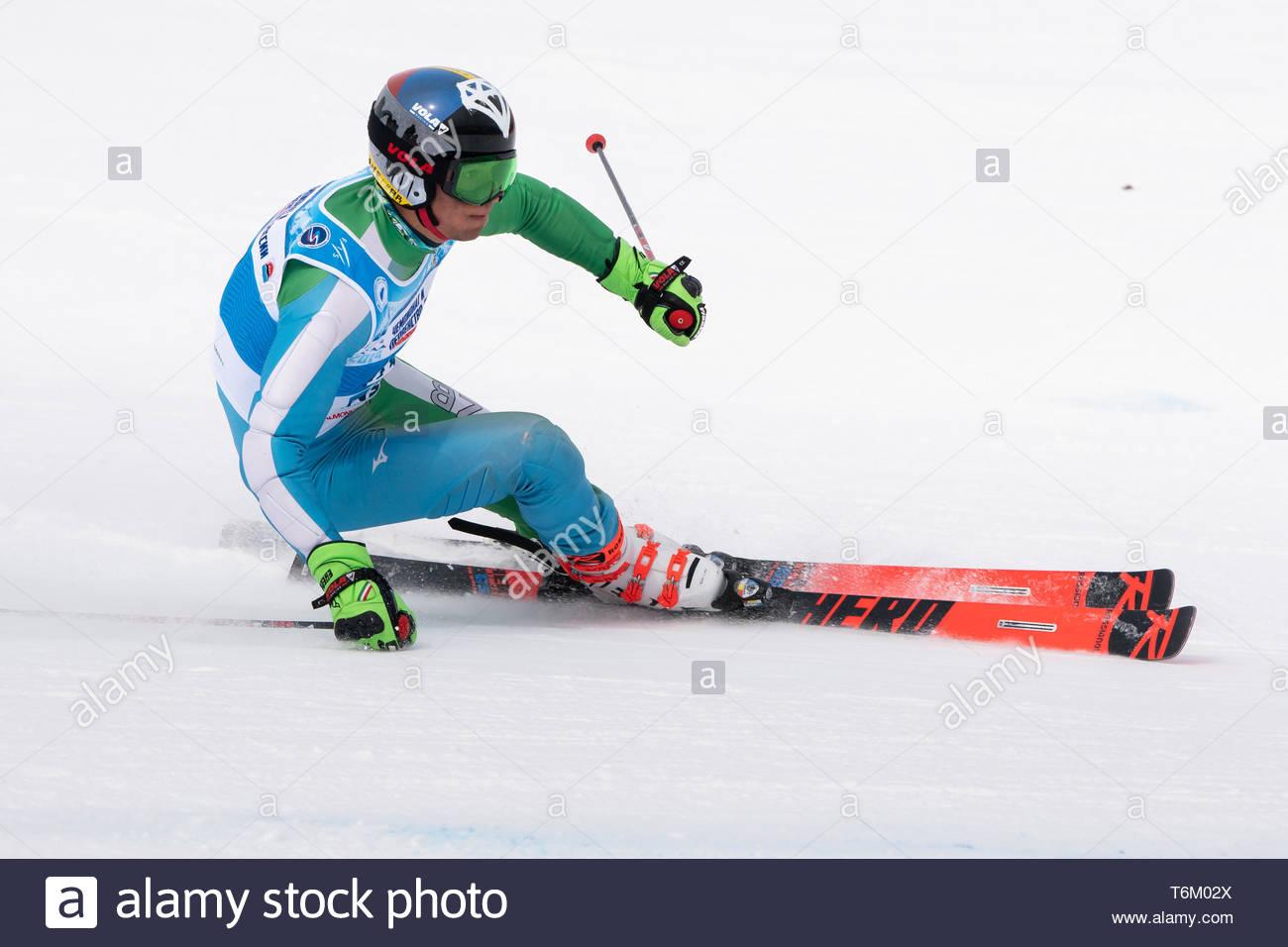 KAMCHATKA PENINSULA, RUSSIAN FEDERATION - APRIL 2, 2019: Mountain skier Komiljon Tukhtaev (Uzbekistan) skiing down snowy mountain slope. International - Stock Image