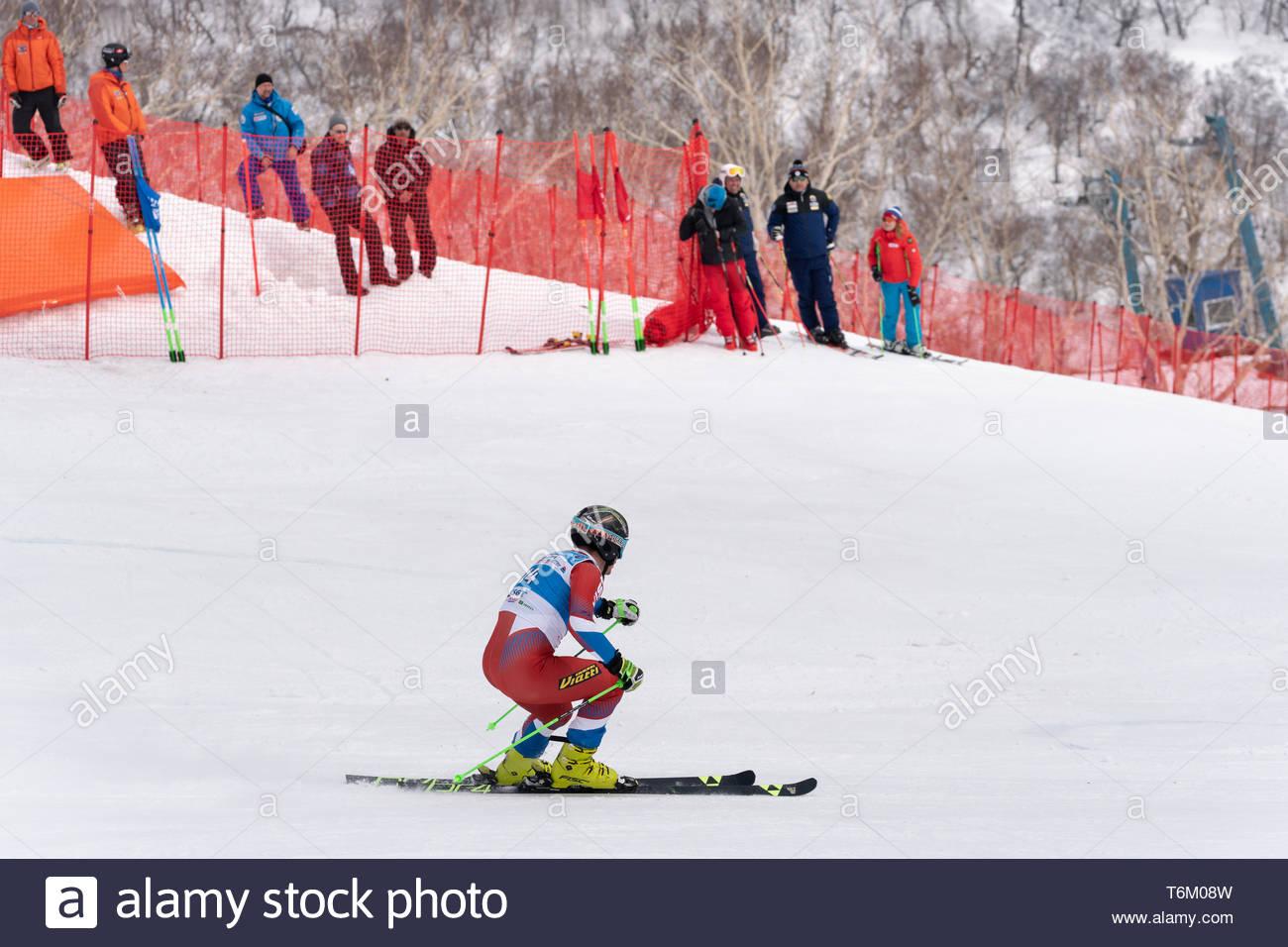 KAMCHATKA PENINSULA, RUSSIAN FEDERATION - APRIL 2, 2019: Russian Men's Alpine Skiing Championship - giant slalom. Mountain skier Ryabitsa Konstantin ( - Stock Image