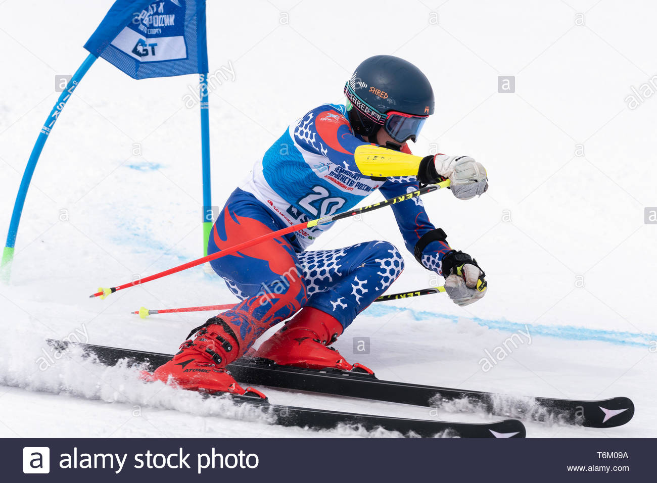 KAMCHATKA PENINSULA, RUSSIAN FEDERATION - APRIL 2, 2019: Russian Men's Alpine Skiing Championship - giant slalom. Mountain skier Prikhodchenko Vadim ( Stock Photo