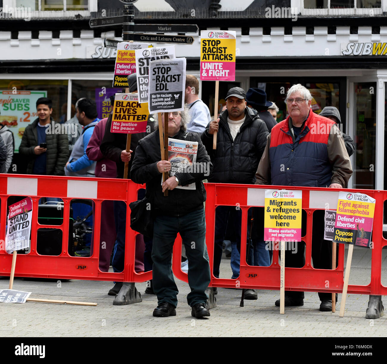 An anti racist protestors confronting The English Defence - Stock Image