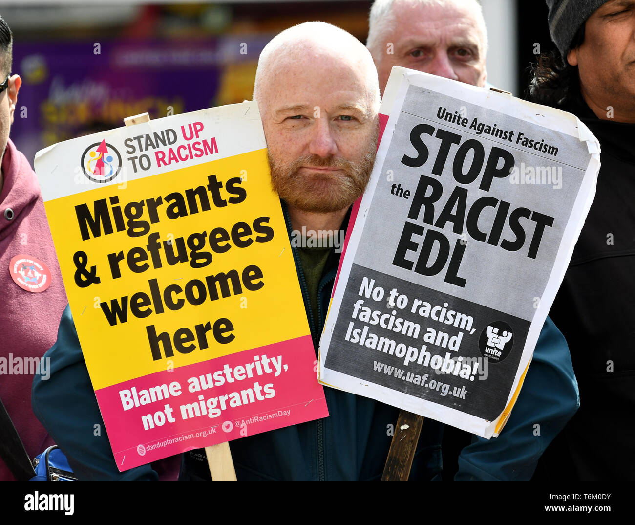 An anti racist protestor confronting The English Defence League Stock Photo