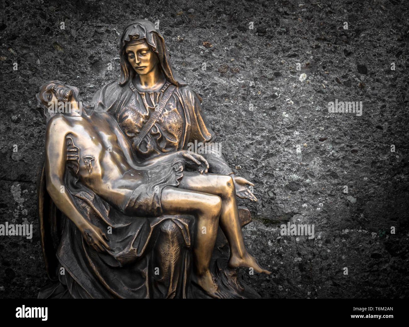 Religious bronze statue representing the piety of Michelangelo - Stock Image