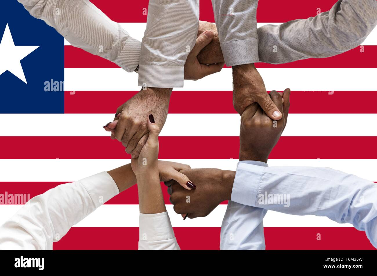 Flag of Liberia, intergration of a multicultural group of young people. - Stock Image