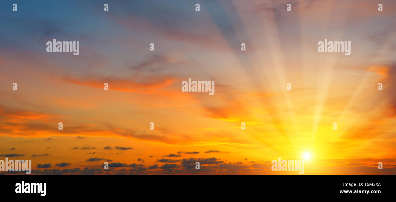 beautiful sun rise and cloudy sky. Wide photo. - Stock Image