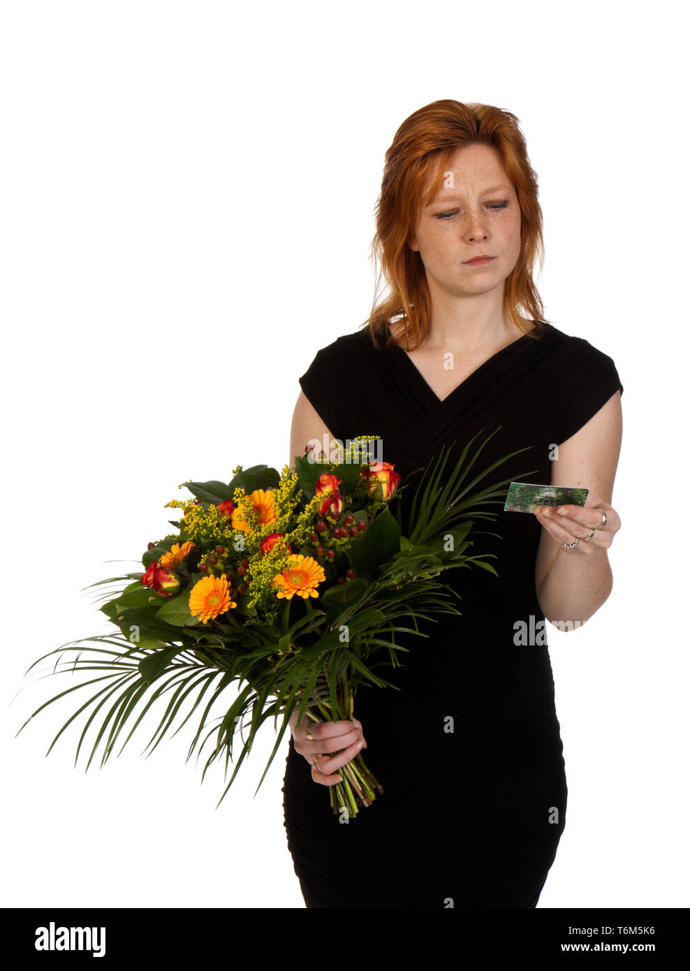 Woman is wondering who sent her flowers? - Stock Image