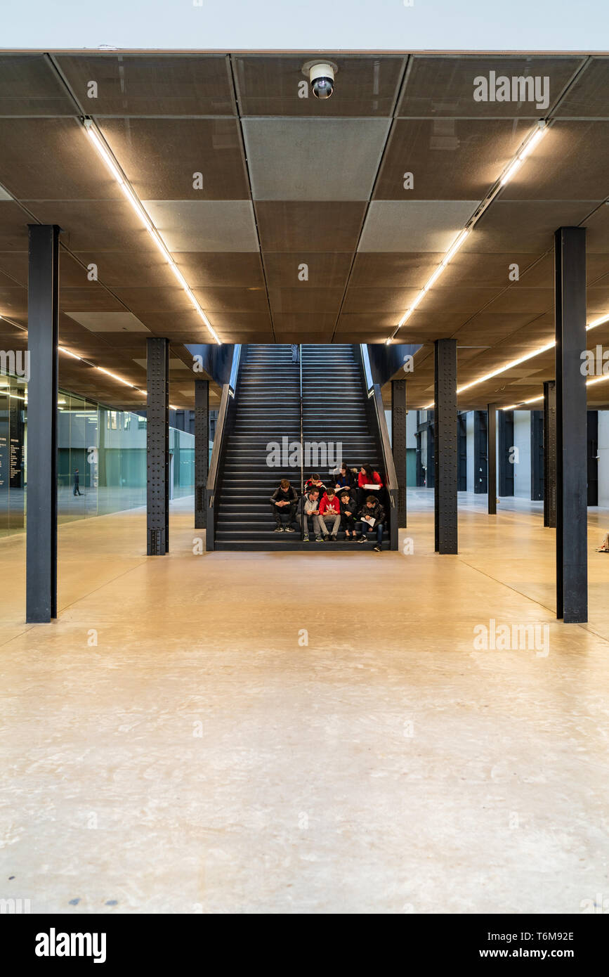LONDON, UK - APRIL 1, 2019: People in interior of Tate Modern Turbine Hall in London Stock Photo
