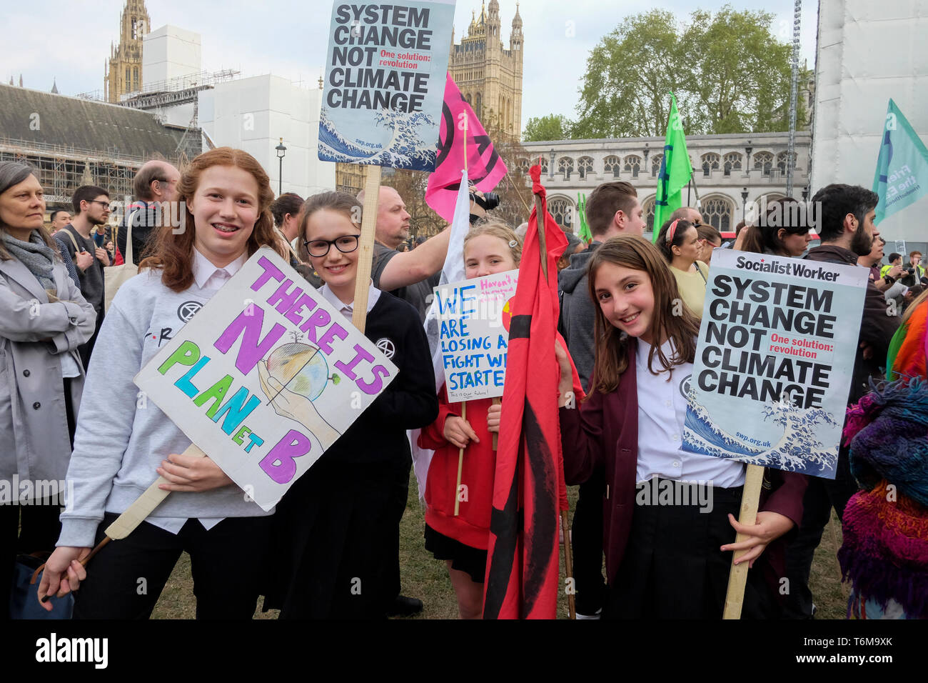 School-age climate protesters attend a Declare A Climate Emergency Now demonstration in Parliament square. Stock Photo
