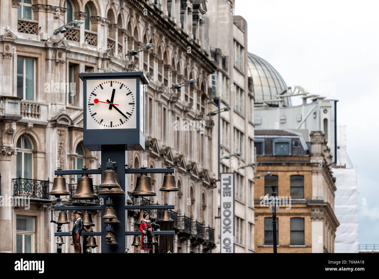 London, UK - September 12, 2018: Leicester Square clock face during day in city with old architecture and the book of mormon sign Stock Photo