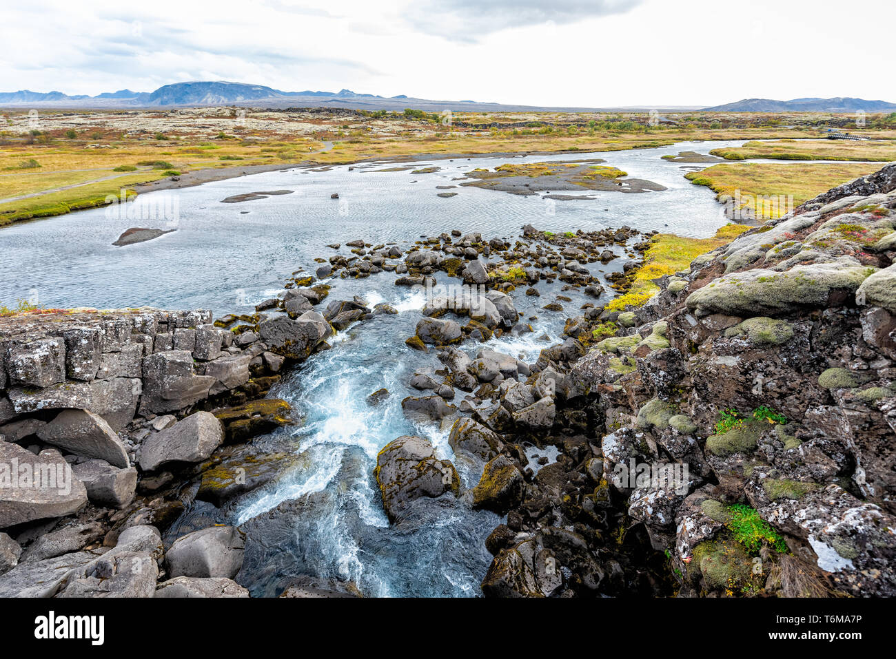 Thingvellir National Park in Iceland Golden circle and small waterfall landscape below called drekkingarhylur Stock Photo