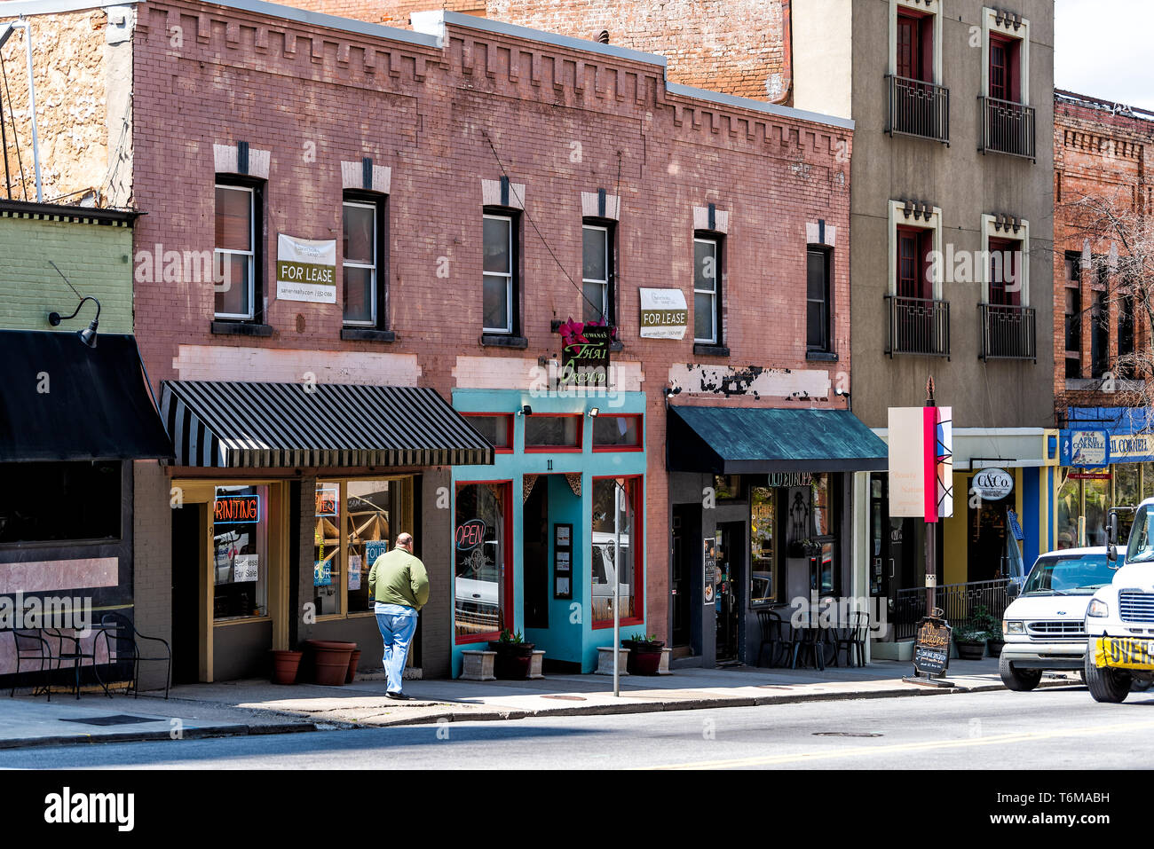 Asheville, USA - April 19, 2018: Downtown old town street in North Carolina NC famous town city in the mountains with stores, shops - Stock Image